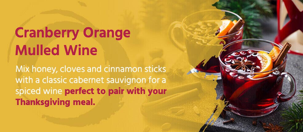 Cranberry Orange Mulled Wine - mix honey, cloves & cinnamon sticks with a classic cabernet sauvignon for a spiced wine - perfect to pair with your thanksgiving meal.