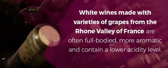 White wines made with varieties of grapes from the Rhone Valley of France are often full-bodied, more aromatic and contain a lower acidity level.