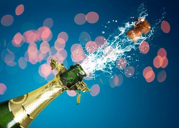 Popping champagne bottle